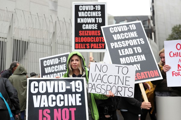 Anti-vaccine protesters hold placards as they take part in a protest against Covid-19 vaccinations in Britain earlier this month. Photo: Reuters