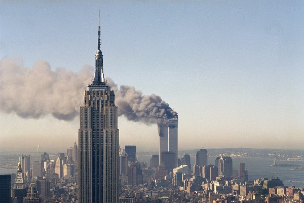 The Twin Towers burn behind the Empire State Building in New York on September 11, 2001. Photo: AP
