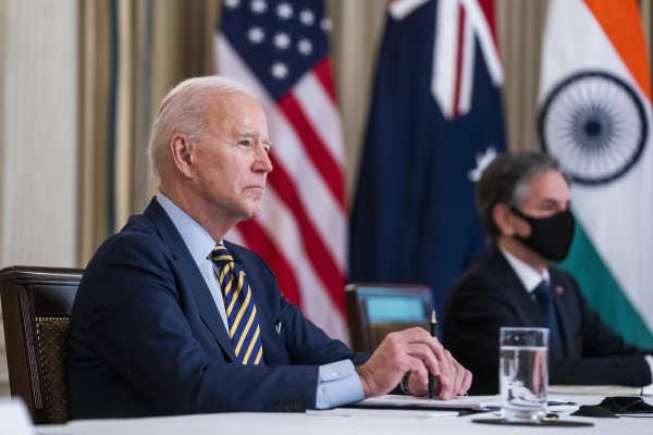 US President Joe Biden and Secretary of State Antony Blinken (right) listen during a virtual Quad meeting with leaders of Japan, Australia and India on March 12. The countries' four leaders will meet at the White House on September 24. Photo: EPA/Bloomberg