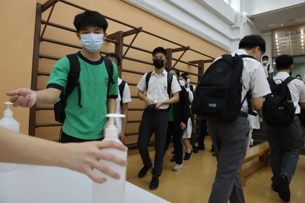 Students use hand sanitiser before beginning their day at Delia Memorial School (Hip Wo) in Kwun Tong on Monday. Photo: Nora Tam