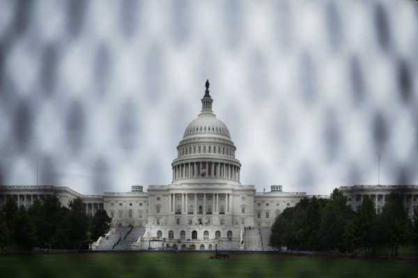 Security crews are using a chain-link fence around the US Capitol building to deter another riot like the one January 6. Photo: AFP
