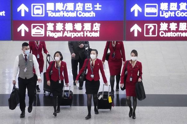 Cathay Pacific staff at the arrival hall at Hong Kong International Airport. Photo: Winson Wong