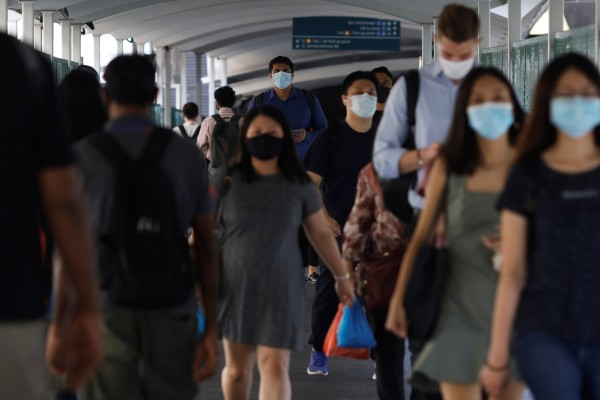 Commuters at a train station in Singapore. Photo: Reuters