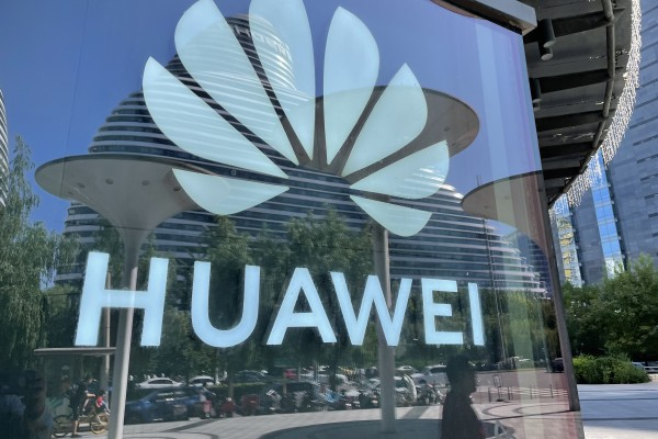 A Huawei logo is pictured on the glass wall of a shopping mall in Beijing, China. Photo: Simon Song