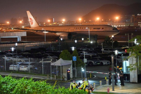 Meng Wanzhou's chartered Air China flight is seen parked on the tarmac at Shenzhen's airport on Saturday night. Photo: Reuters