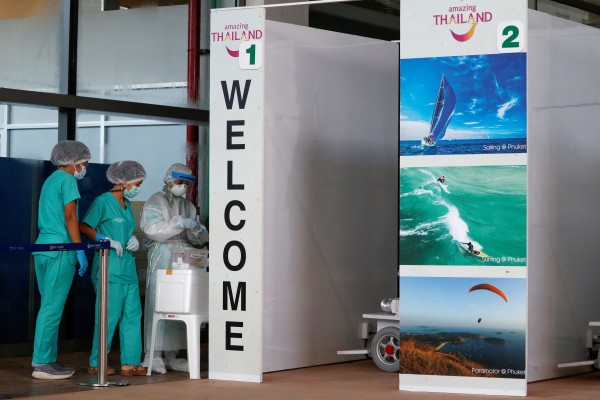 Health workers stand at the Covid-19 swab test area at the airport after Phuket reopened to vaccinated overseas tourists. Photo: Reuters