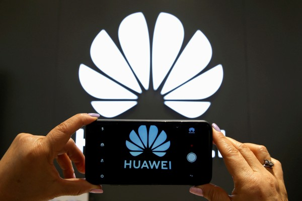 A Huawei logo is seen on a cell phone screen in their store at Vina del Mar, Chile July 18, 2019. Photo: Reuters