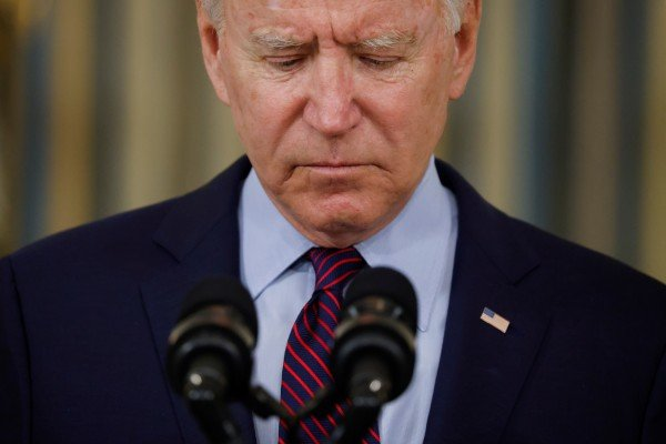US President Joe Biden looks down as he delivers remarks on the US debt ceiling from the State Dining Room of the White House on Monday. Photo: Reuters