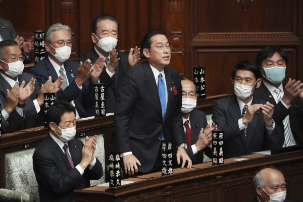 Fumio Kishida is applauded after being elected as Japan's new prime minister at the parliament's lower house in Tokyo. Photo: AP