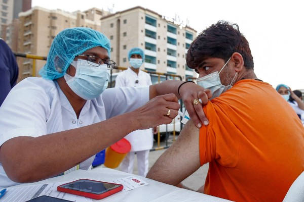 A man receives a Covid-19 vaccine shot in Kuwait City. Photo: AFP