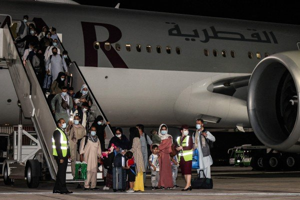 Evacuees from Afghanistan, including US citizens, arrive at Hamad International Airport in Qatar's capital Doha on September 9. File photo: AFP