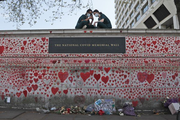 The National Covid Memorial Wall in London. Covid-19 is still killing hundreds of people every week in Britain. Photo: AP