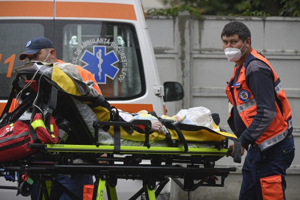 Paramedics bring an elderly patient to the emergency-room-turned-Covid-19-unit at a hospital in Bucharest, on Tuesday. Photo: AP