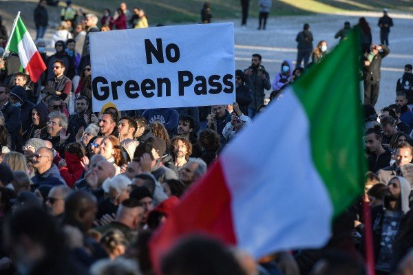 People gather during a protest against Italy's green pass at the Circus Maximus in Rome on Friday. Photo: AFP
