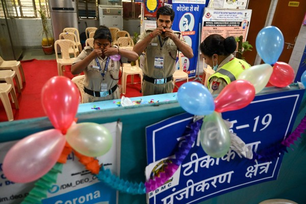 Volunteers decorate a vaccination centre to celebrate India administering its billionth Covid-19 shot at a health centre in New Delhi on Thursday. Photo: AFP