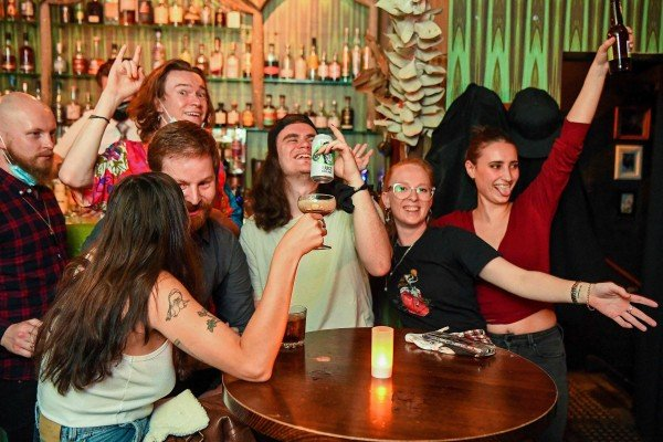 People celebrate in a bar in Melbourne on Friday. Photo: AFP