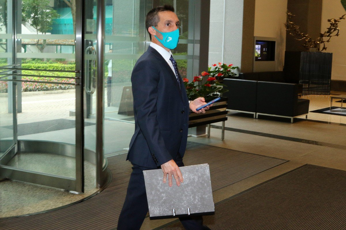 Neil Callan enters HKJC headquarters for his licensing committee hearing. Photos: Kenneth Chan