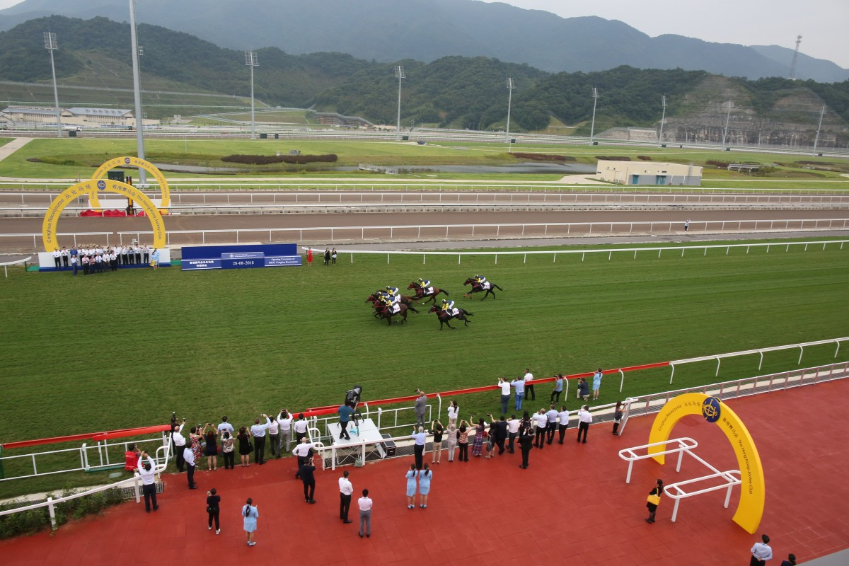 Six horses gallop down the straight at the opening of the Conghua Racecourse in August. Photos: Kenneth Chan