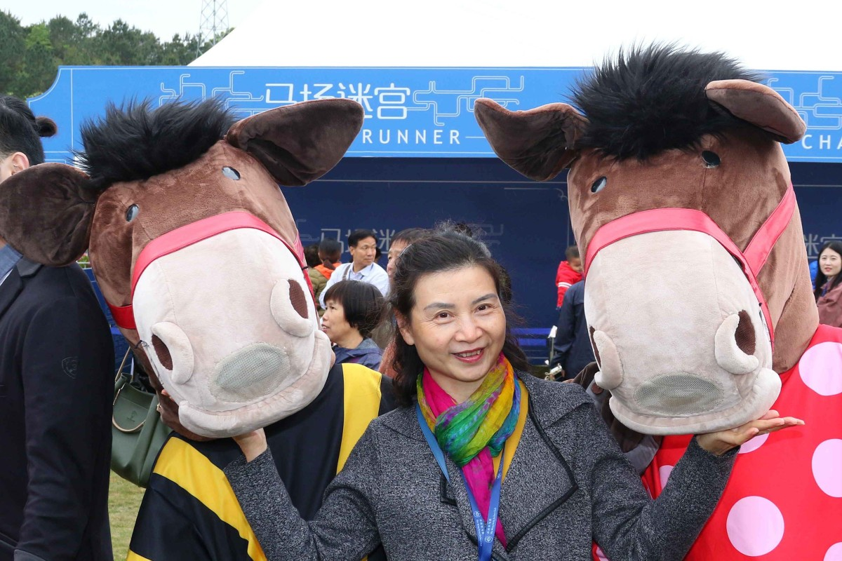 """Chinese racing fans play in the """"fun zone"""" at Conghua Racecourse on Saturday. Photos: Kenneth Chan"""