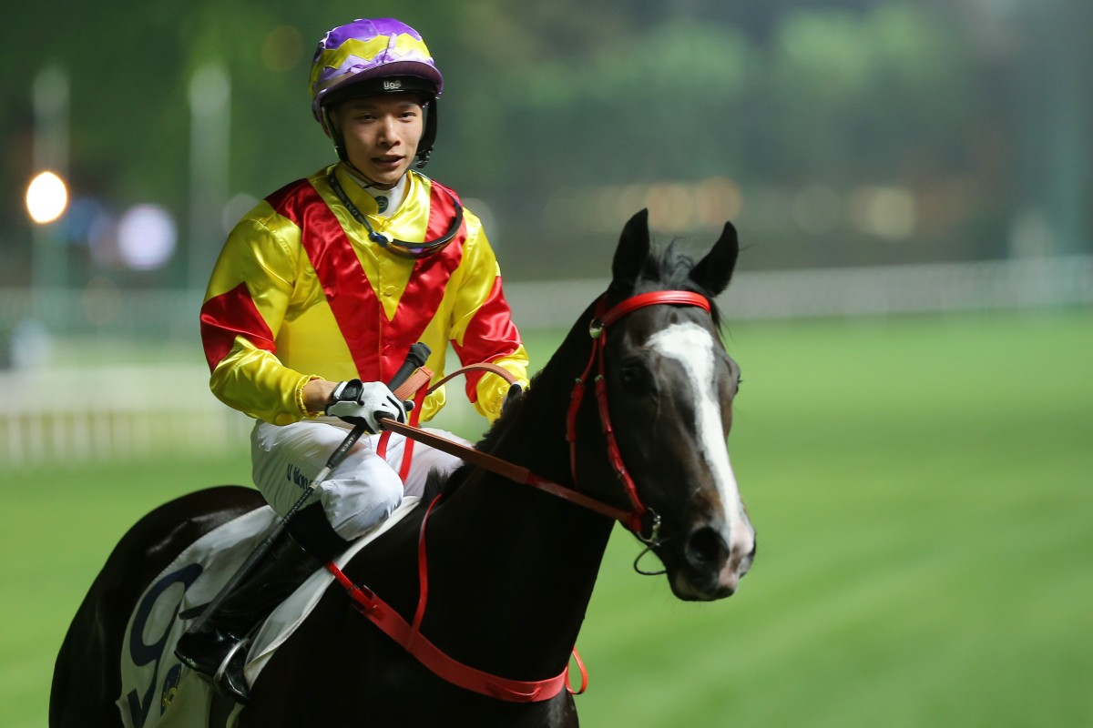 Victor Wong after winning on Frustrated at Happy Valley. Photos: Kenneth Chan