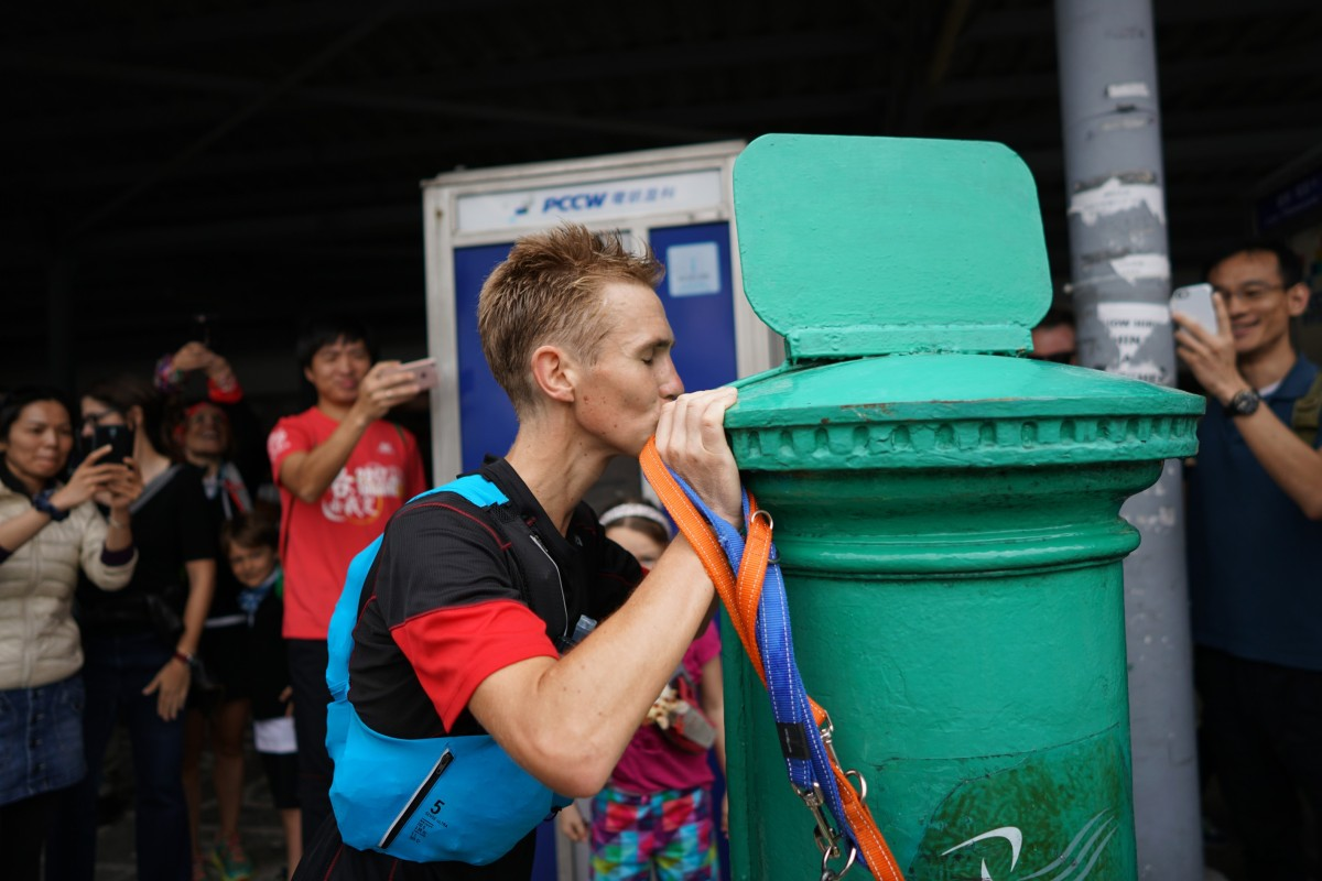 Tom Robertshaw kisses the postbox marking the end of the 298km HK4TUC. Carr believes Robertshaw's experience stands him in good stead for the never ending Big Boar's Backyard Ultra. Photo: Lloyd Belcher