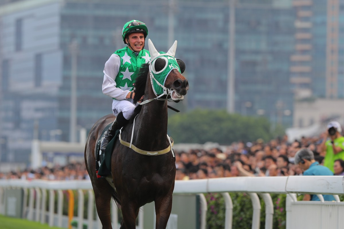 William Buick returns to scale after winning the 2018 QE II Cup with Pakistan Star. Photos: Kenneth Chan