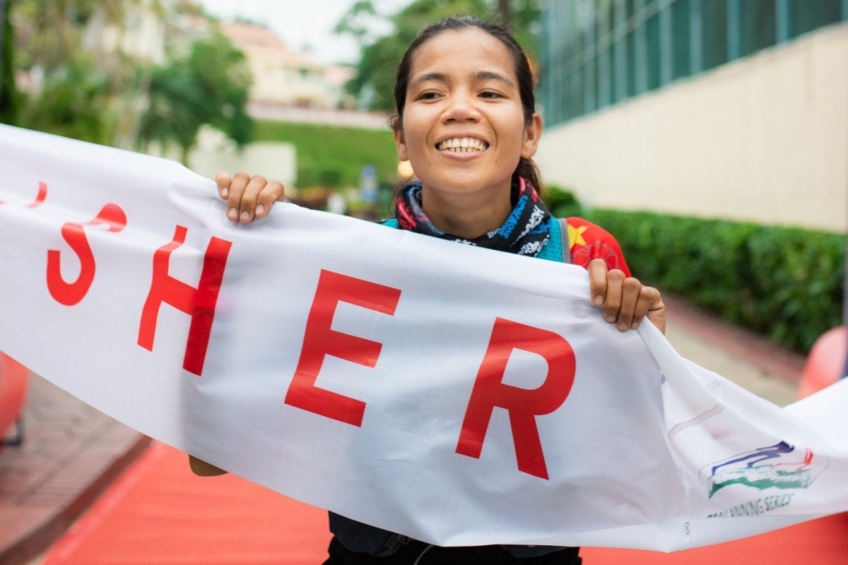 Fredelyn Alberto wins the 75km Green Race. She uses running to assert her identity away from her 'status' as a domestic helper. Photo: Kirk Kenny