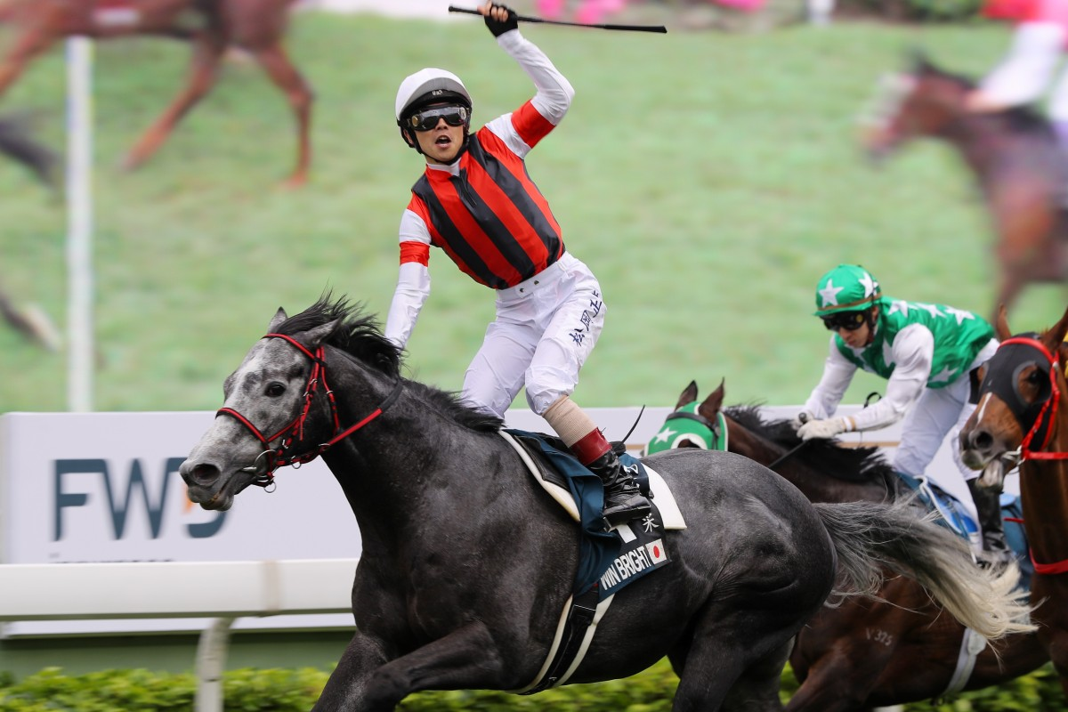 Jockey Masami Matsuoka celebrates the win aboard Win Bright in the Group One QE II Cup (2,000m) at Sha Tin on Sunday.