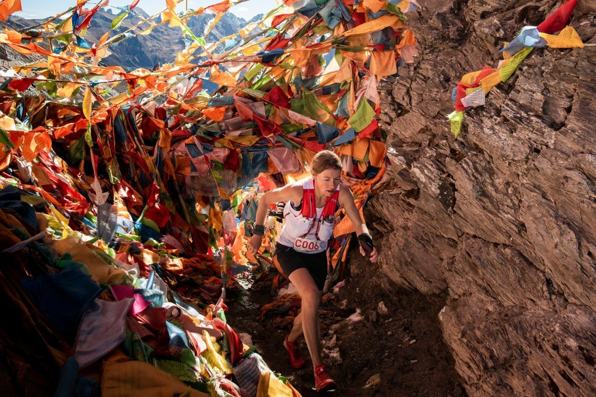 Megan Kimmel, the eventual winner, runs through mountains of prayer flags. The local culture is one reason to make the trip. Photo: Kirk Kenny/MRSWS/Studio Zag
