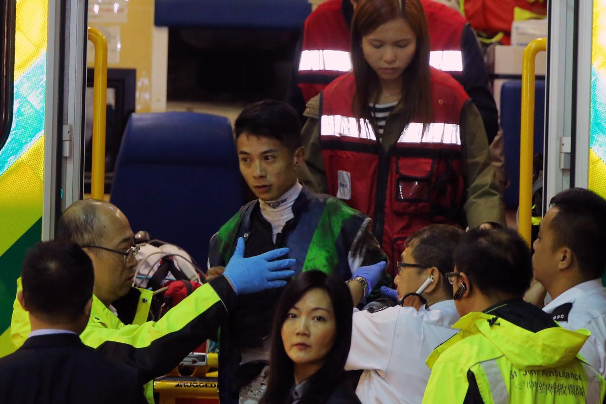 Derek Leung in the care of paramedics after his fall on Gameplayer Emperor last week. Photos: Kenneth Chan