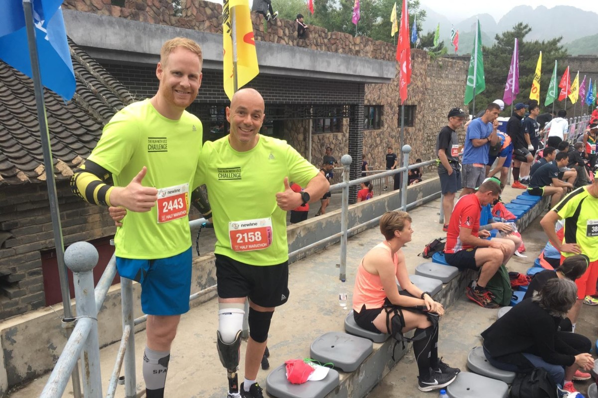 Michael Robbert-Bran and Rick Geurtsen ran the Great Wall Marathon leaving others reflecting on their own lives as the two overcame the amputations.