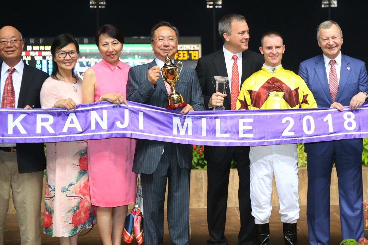 Boniface Ho (middle) collects the 2018 Kranji Mile trophy after winning with Southern Legend. Photos: Kenneth Chan