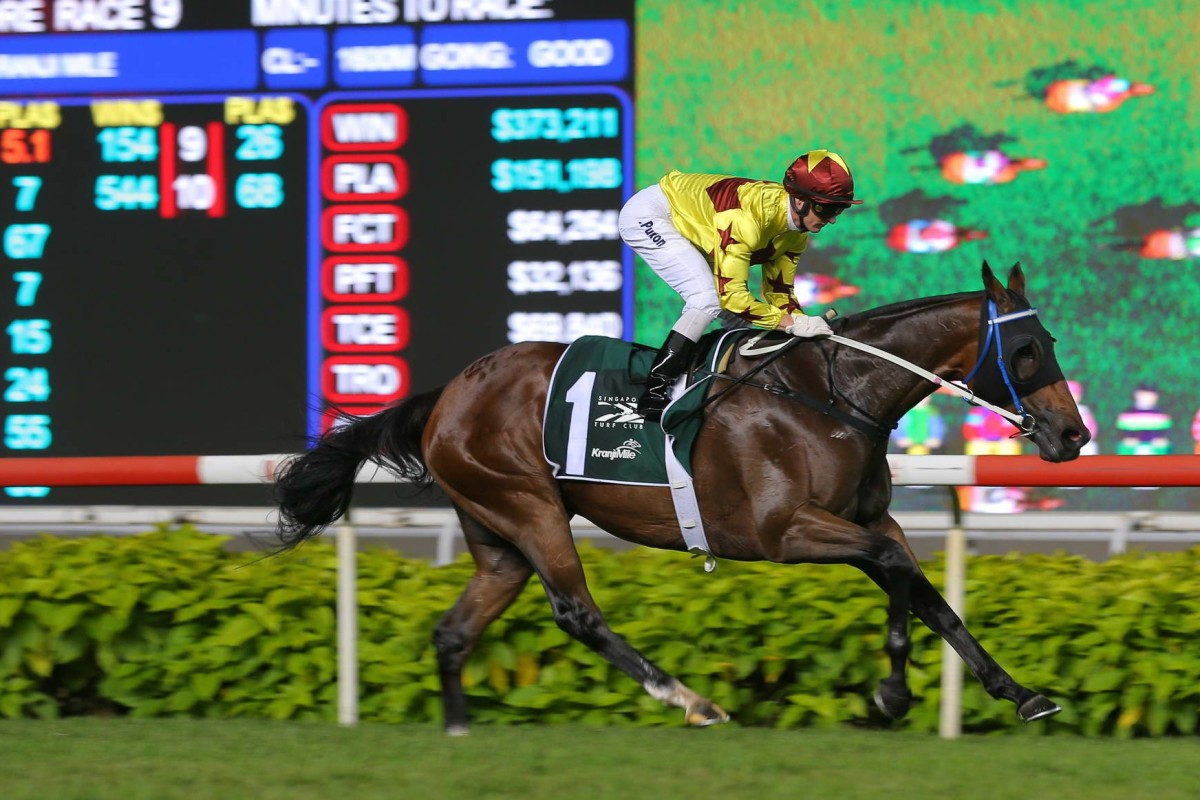 Zac Purton and Southern Legend coast to victory in the Kranji Mile at Singapore Racecourse. Photos: Kenneth Chan