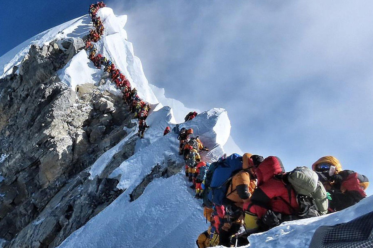 This handout photo taken on May 22, 2019 and released by climber Nirmal Purja's Project Possible expedition shows heavy traffic of mountain climbers lining up to stand at the summit of Mount Everest. Photo: AFP