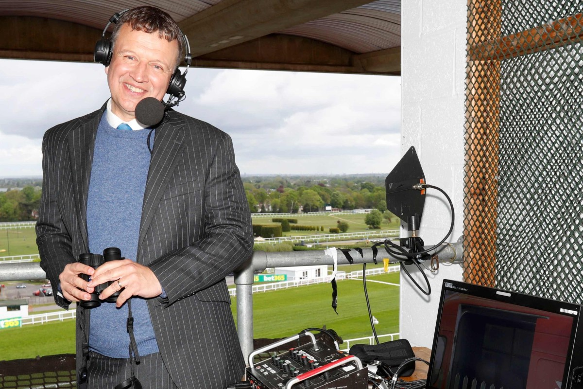 Racing commentator Richard Hoiles in the calling box. Photo: AFP