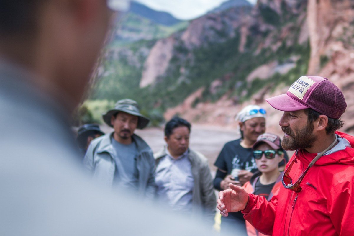 Travis Winn addresses his team during a river trip, but the rafting is only part of his wider goal to save Chinese rivers. Photo: Wang Heng
