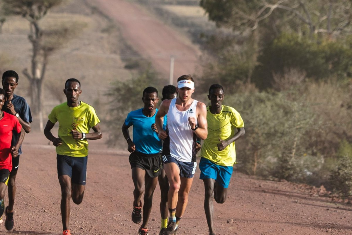 Tom Evans with the group of elite Ethiopian runners in a high-tempo training session. Photos: Max Willcocks