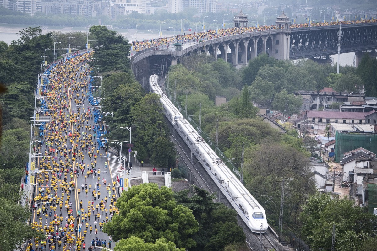 Runners cross the Wuhan Yangtze River Bridge during the 2019 Wuhan Marathon in Hubei province, China. About 24,000 participants took part. Photo: Xinhua