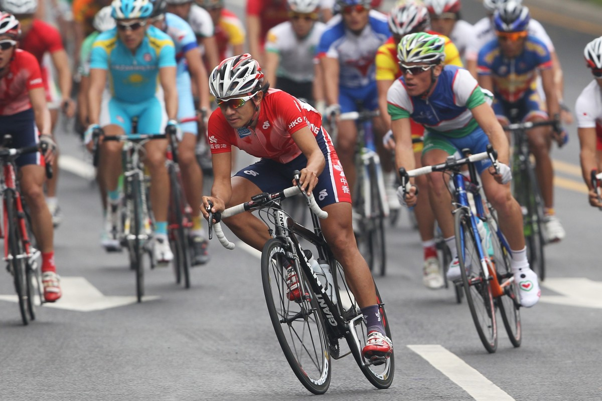 Wong Kam-po on his way to winning gold in the road race at the 2010 Asian Games in Guangzhou. Should he have tried his luck in Europe? Photo: SCMP