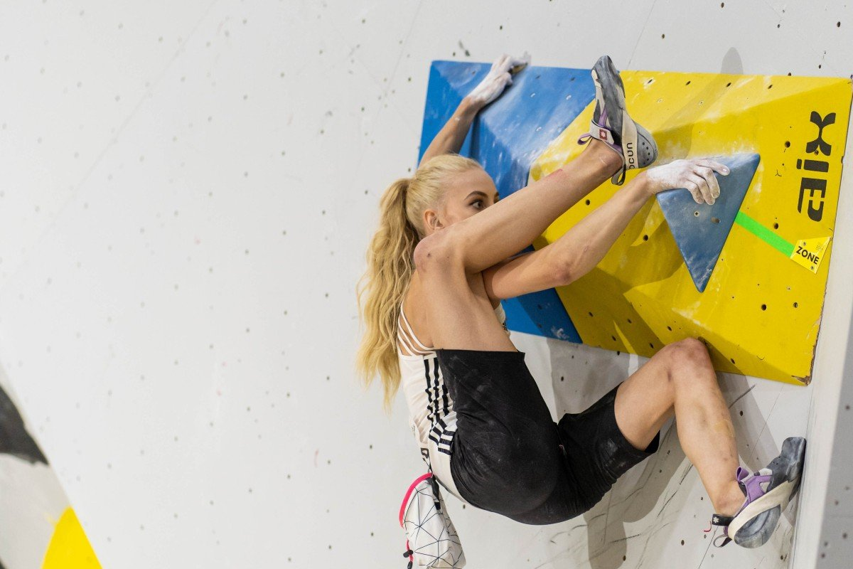 Slovenia's Janja Garnbret hangs on a boulder problem during the IFSC World Championships in Hachioji, Japan, which is doubling up as the Olympic qualifier for climbing. Photo: Eddie Fowke - IFSC