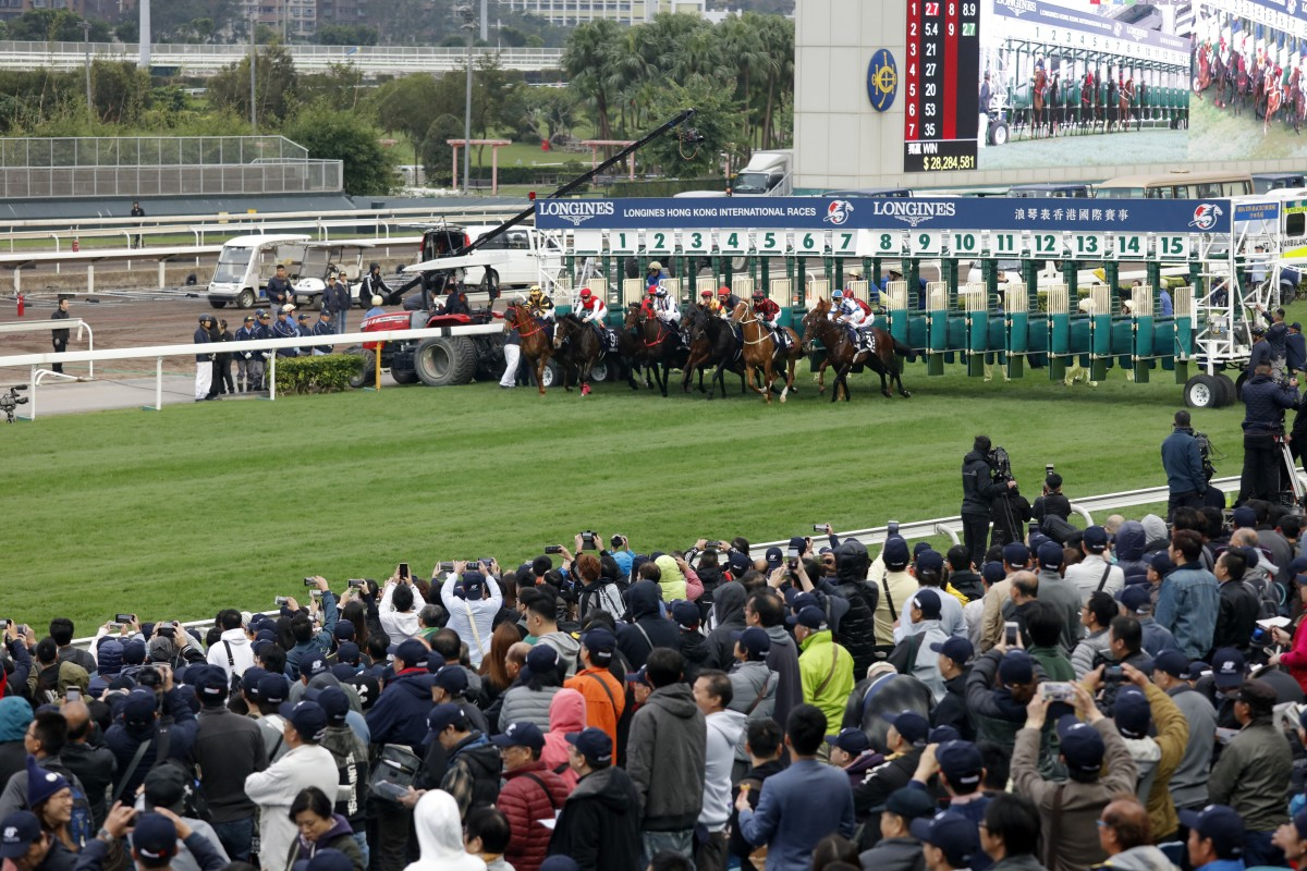 The crowd cheers as horses take off to race in Hong Kong. Photos: Kenneth Chan