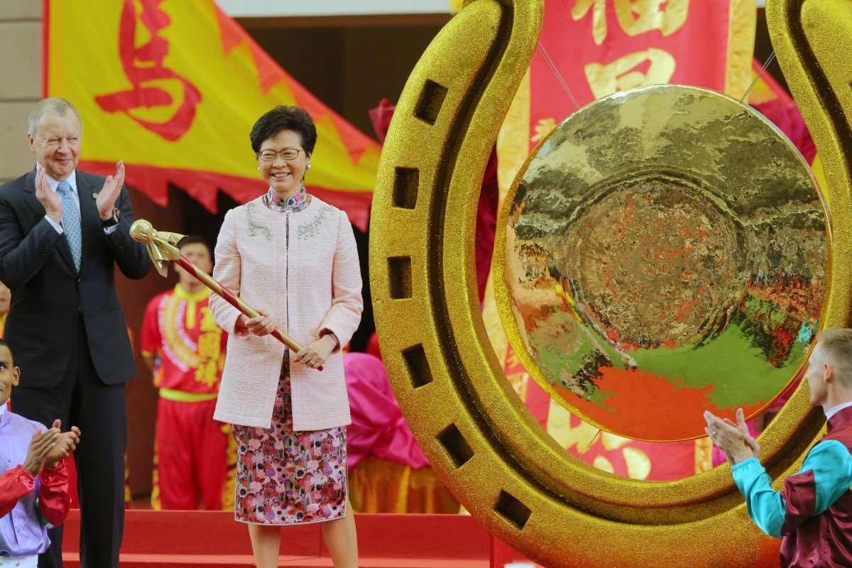HKSAR Chief Executive Carrie Lam gets ready to strike the gong to signal the start of the 2018-19 racing season. Photos: Kenneth Chan