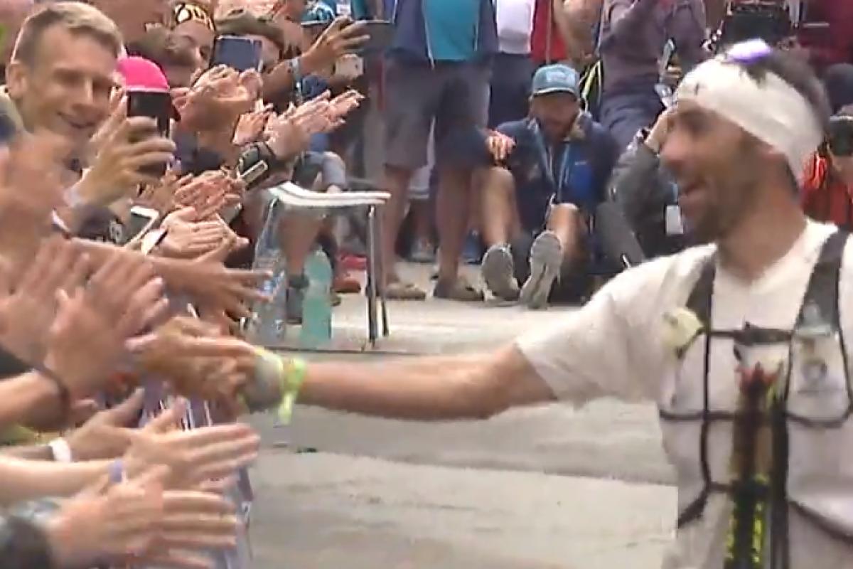 Winner of the CCC, UTMB, Luis Alberto Hernando Alzaga, high fives the crowd. Photo: UTMB TV