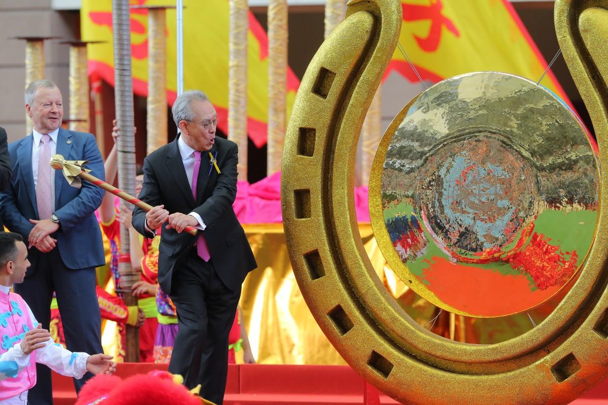 Hong Kong Jockey Club chairman Anthony Chow opens the racing season by striking a gong at Sha Tin. Photos: Kenneth Chan