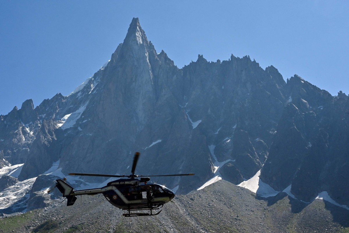A helicopter flies over the Mont Blanc Massif - the mayor worries they will need a helicopter to remove a rowing machine left by a 'wacko' on Mont Blanc. Photo: Philippe Desmazes/AFP