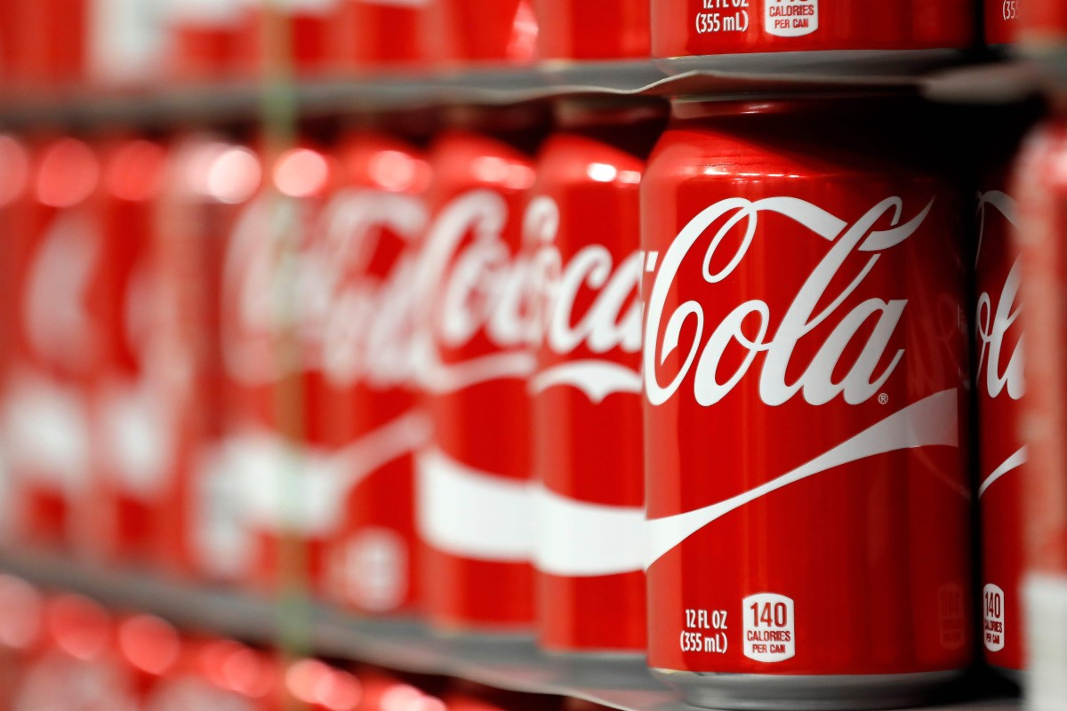 Coca-Cola offers easy calories to a trail runner desperate to replenish dwindling energy, but what is it doing to their oral hygiene? Photo: AFP