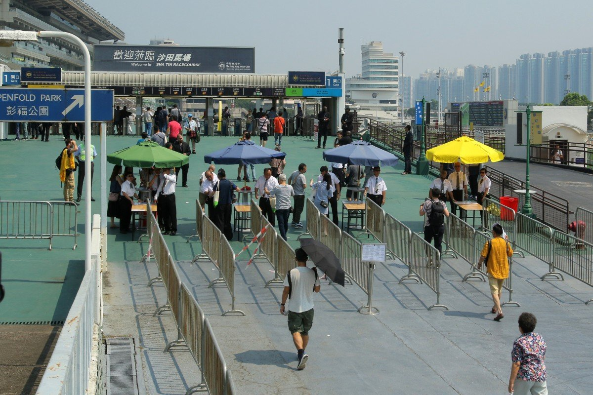 Fans enter Sha Tin on Tuesday. Photo: Kenneth Chan