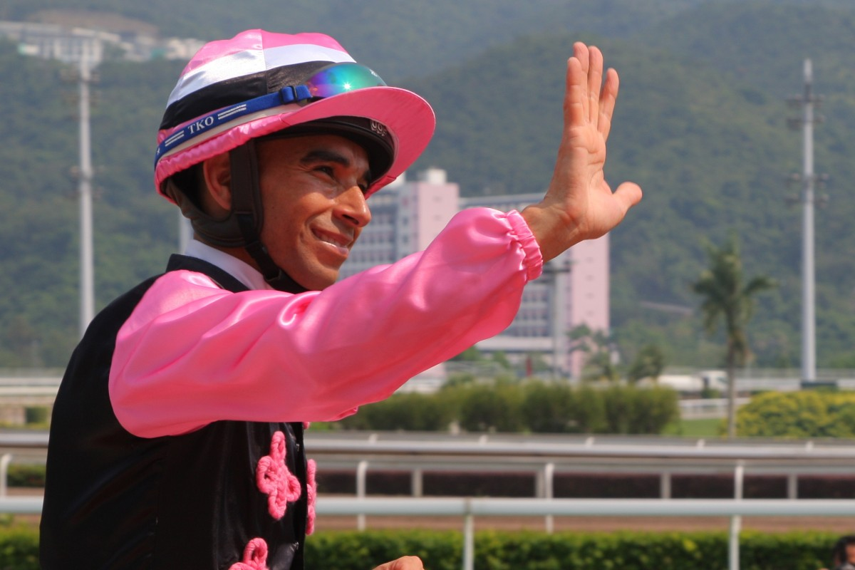 Joao Moreira celebrates his win aboard Full Of Beauty on National Day. Photos: Kenneth Chan