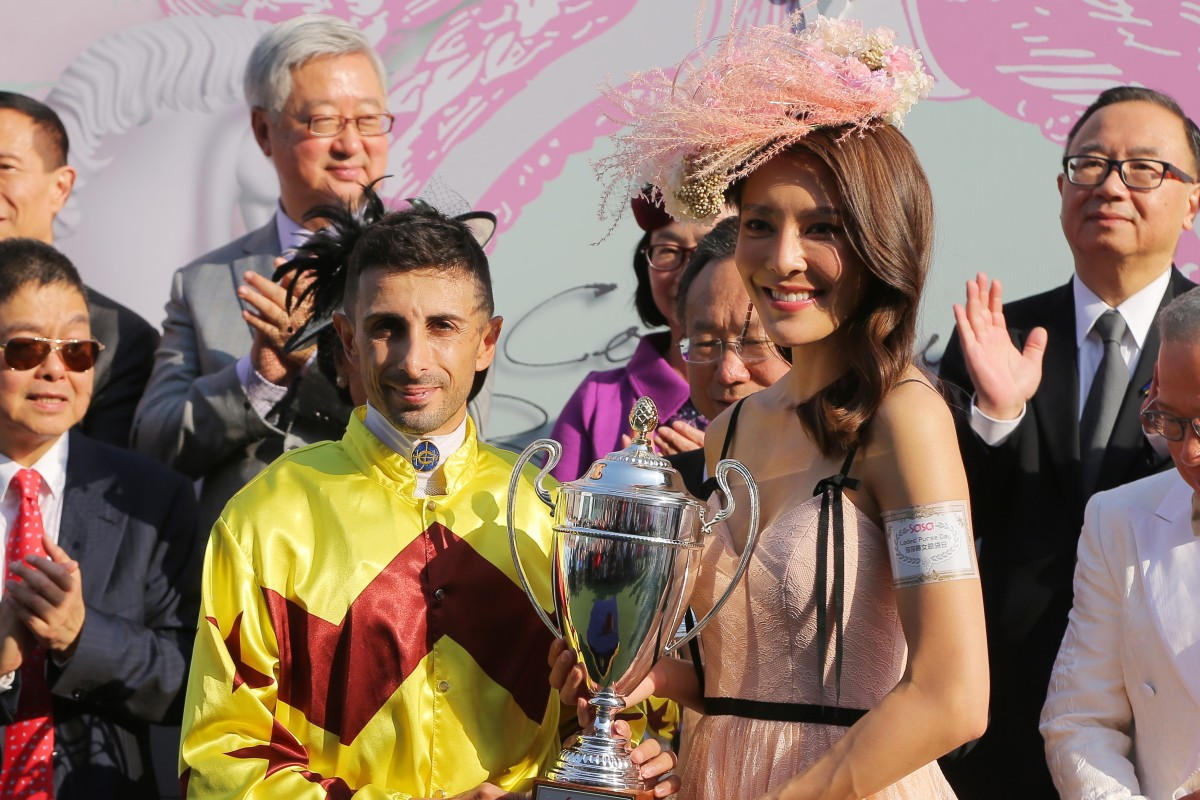 Kelly Cheung presents the trophy to winning jockey Alberto Sanna. Photos: Kenneth Chan