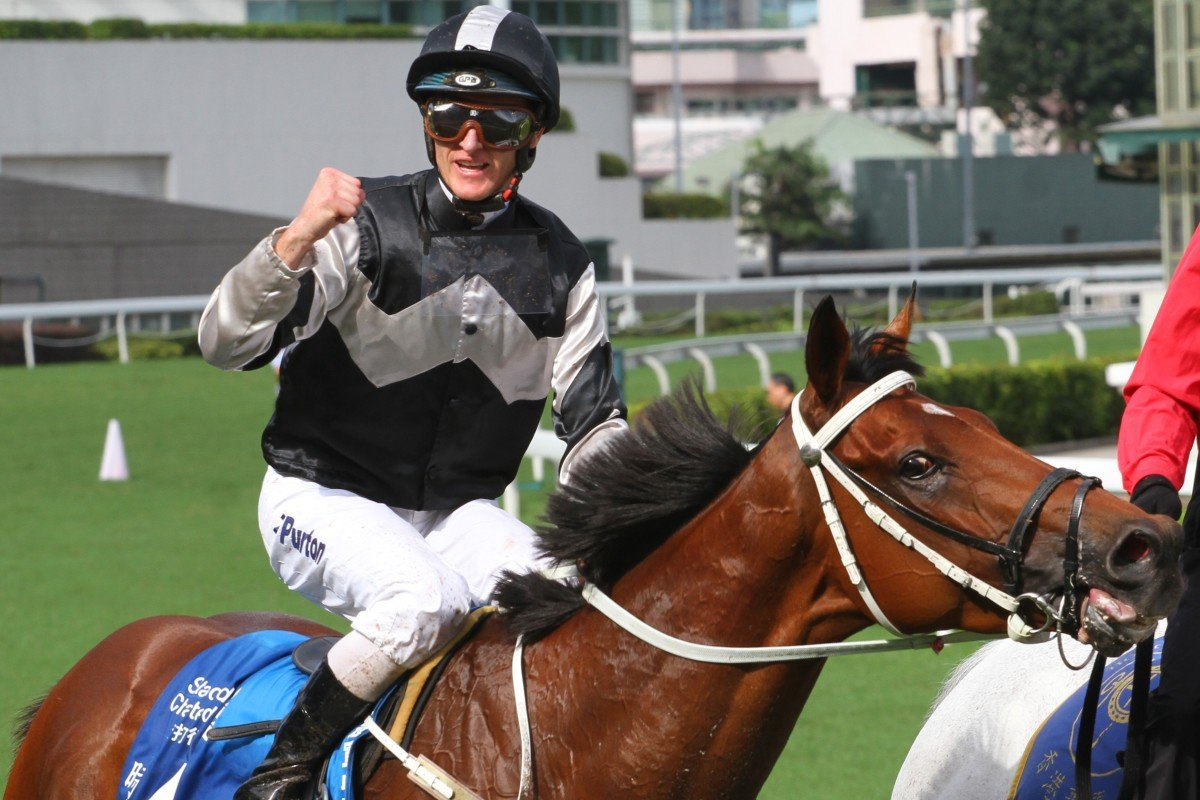 Zac Purton celebrates the win of Exultant last year. Photos: Kenneth Chan